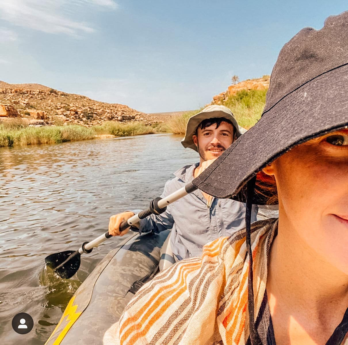 man and woman canoeing at bliss and stars